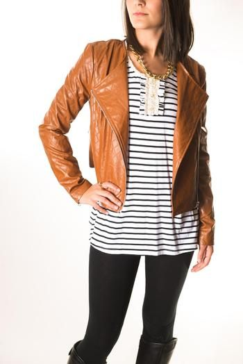 Camel colored faux leather jacket. Nice and structured with quilted detail and silver zippers.