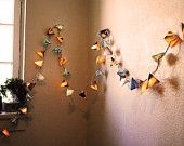 Rainbow Neon Garland - Paper Pyramid Lanterns - Short Strand. $45.00, via Etsy.
