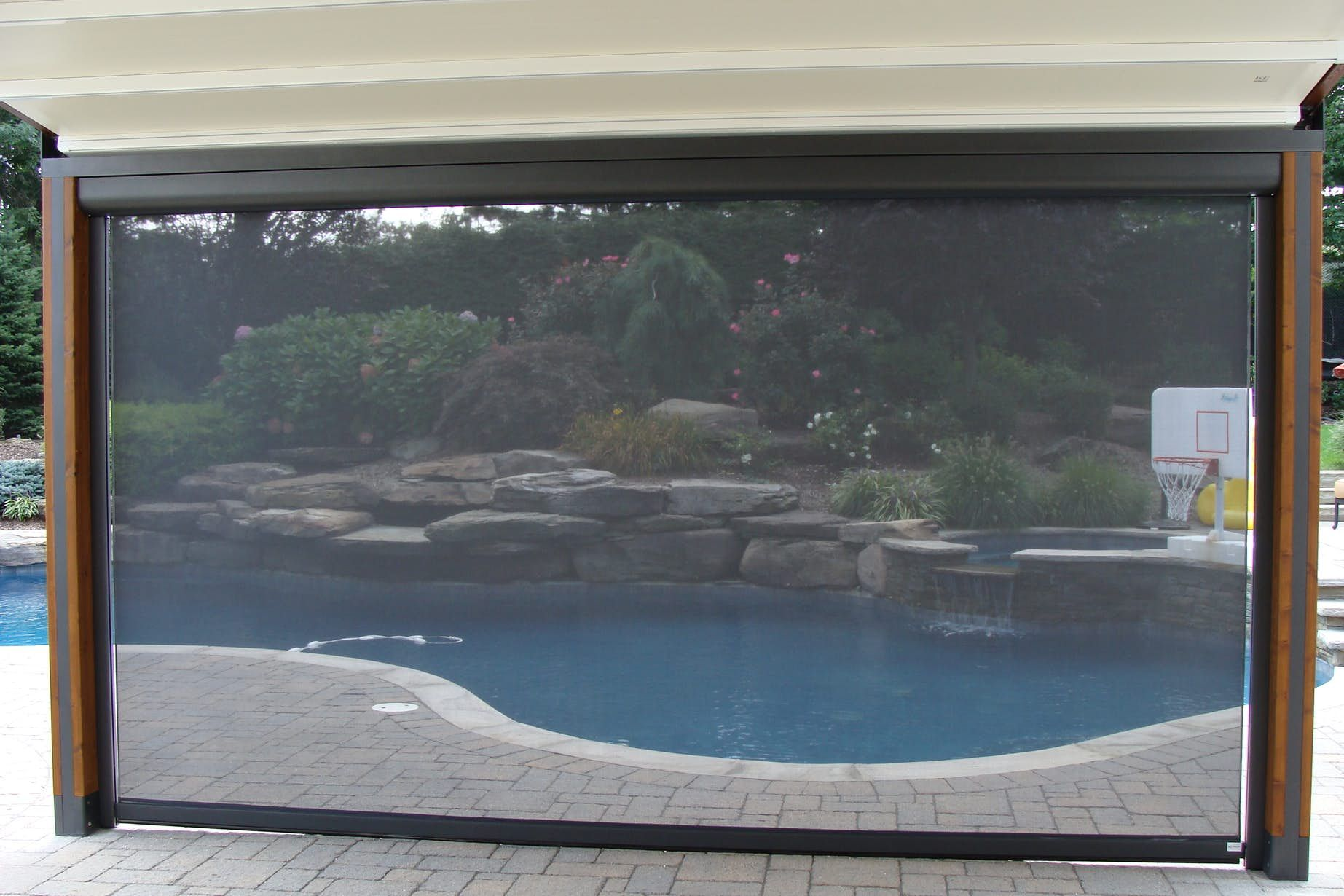View of the backyard through the solar shade fabric outside living