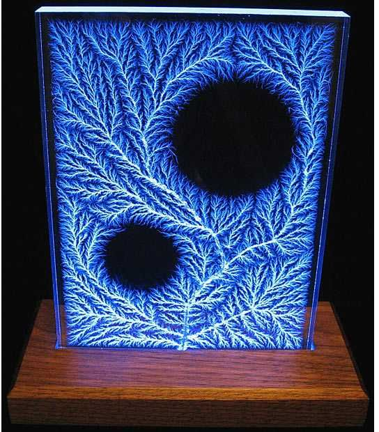http://www.everythingselectric.com/images/captured-lightning-lichtenberg-figures-holes.jpg