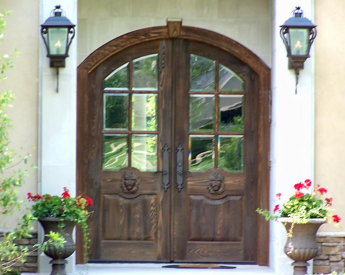 This pair of custom 36 x 84 distressed cypress 6 lite for French style front door