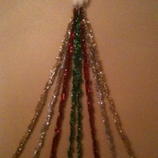 Tinsel Wall Christmas Tree Made Of Tinsel Using Some Twine Hooks And An Empty Wall Wall Christmas Tree Christmas Party Decorations Christmas Bulbs