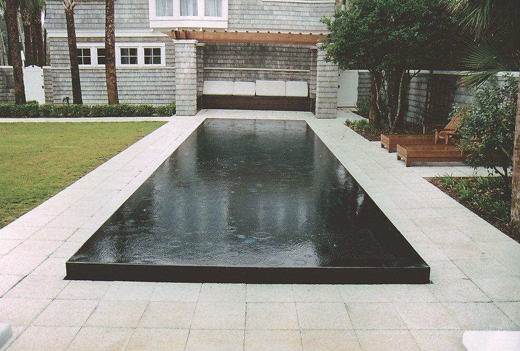 Perimeter overflow pool designs the raised perimeter for Garden pond overflow design