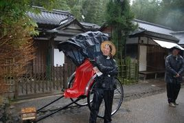 Pedicabs, like this one in Kyoto, Japan, are wonderful ways to see the community even in the rain.