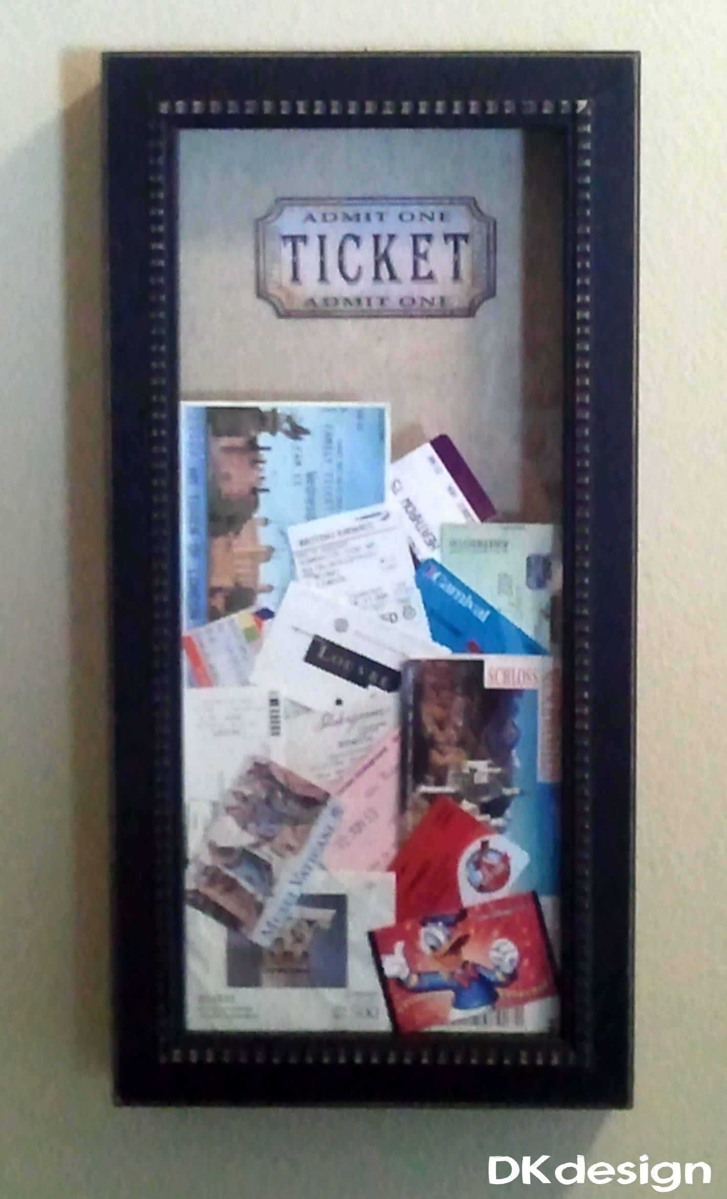 "Great place to keep all of the ticket stubs from our travels and special events. 10"" X 20"" Shadow box from Hobby Lobby $20.00 (40% off) and printed a picture of an old fashion ticket for the background. Cut a slot in the top to drop the tickets."