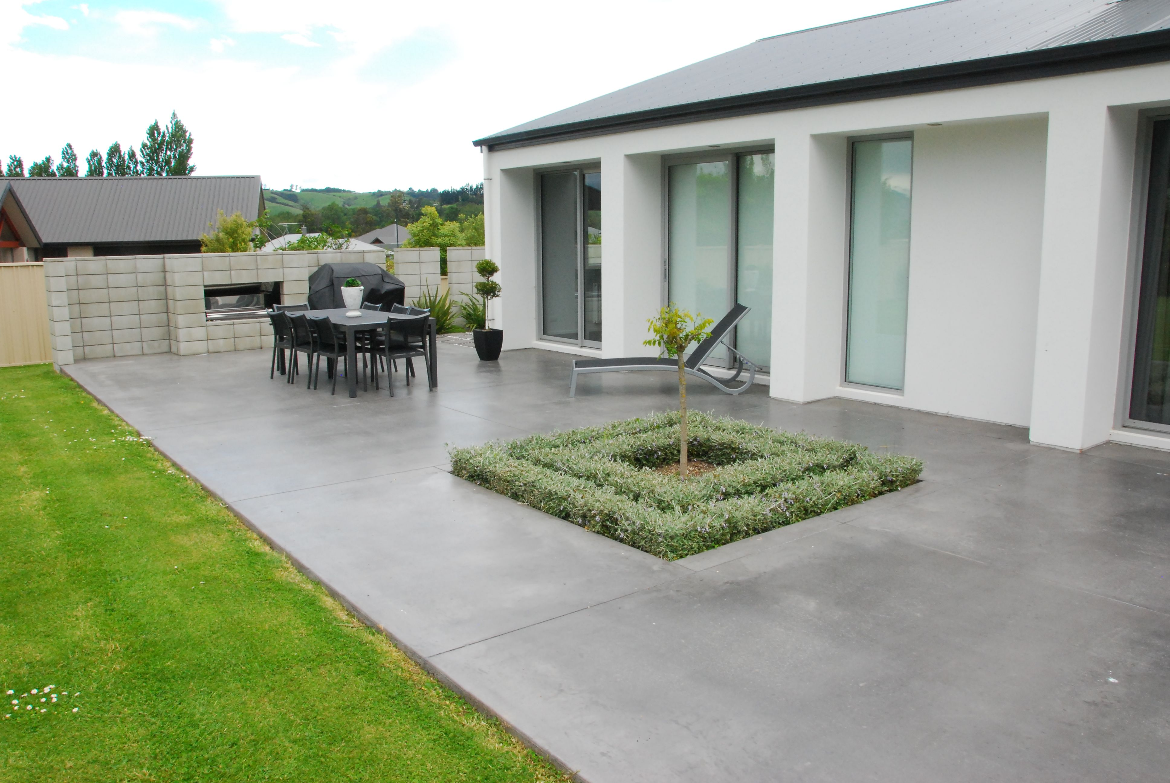 Coloured Concrete Patio In Charcoal Outdoorsy