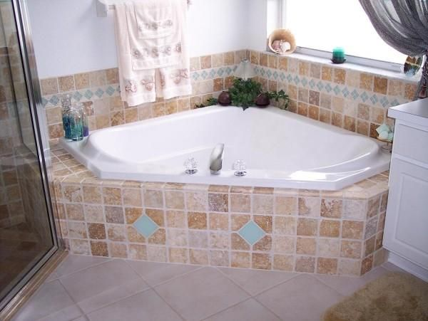 garden tub tile pictures       travertine glass tile garden tub master bath  florida. bathroom floors   The latest trends in tile floors for your home