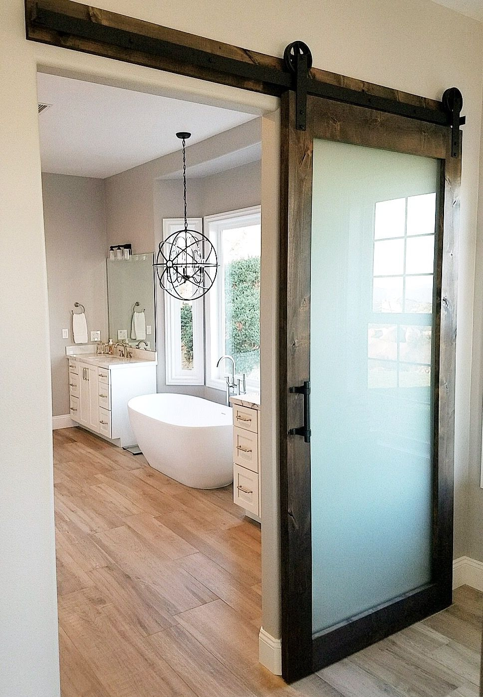 Frosted Glass Knotty Alder Barn Door With Hardware For A Master Bedroom Bathroom Glass Barn Doors Barn Doors Sliding Master Bedroom Bathroom