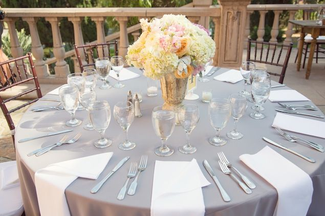 Grey/silver tablecloths and white napkins - you get the idea.  You can slip the menu card/welcome note in the napkin fold-over