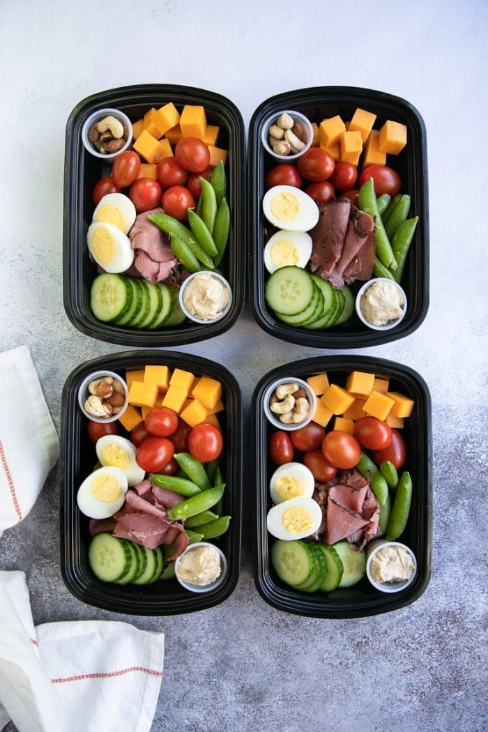 Protein Snack Packs filled with hard-boiled eggs almonds hummus and crunchy v