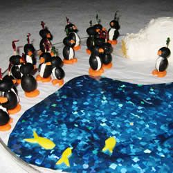"""Cream Cheese Penguins...Used wrapping paper for """"water"""" cut veggies for fish (or use Goldfish [TM] crackers. Igloo is feta and cream cheese dip"""