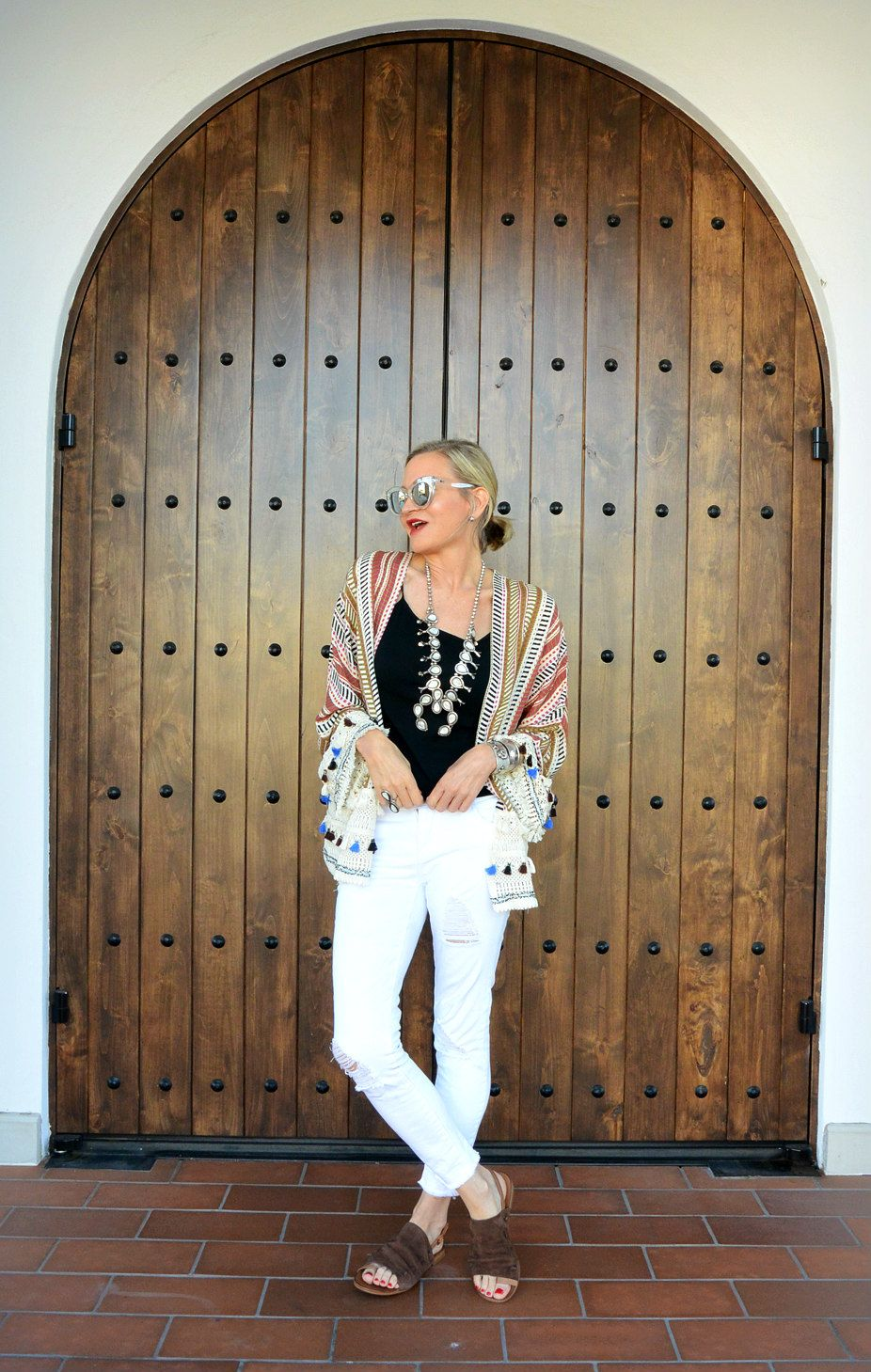 White jeans with black tank.  Add kimono jacket and white squash blossom necklace with comfy leather sandals and good to go!