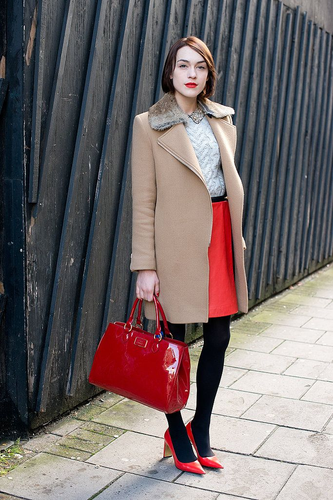 Colors only! Ella Catliff knows that a little red goes a long way and happens to look gorgeous with a camel-hued coat.