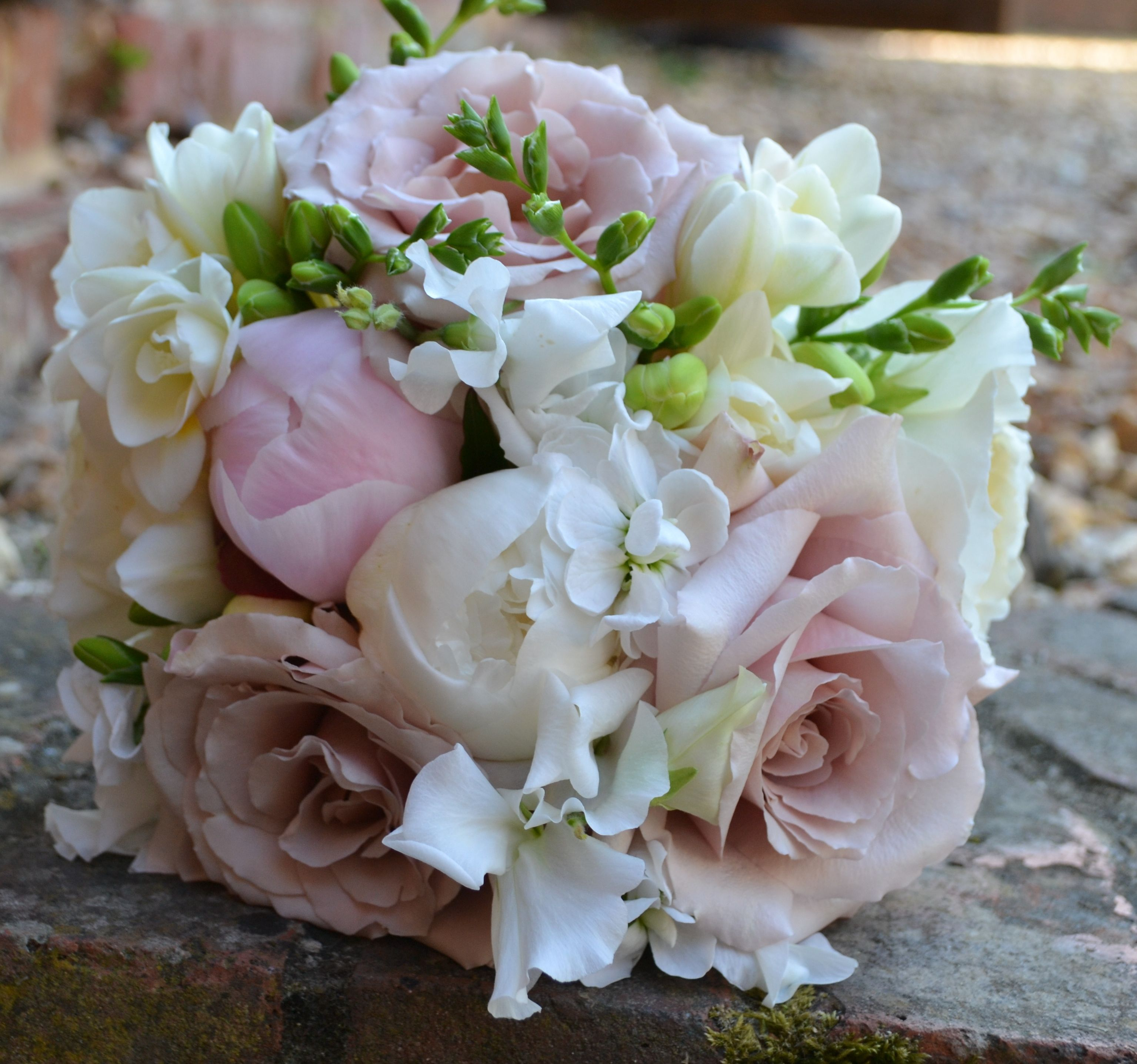 2ee134fad7 Bridal bouquet of white freesia, pale pink peony and quick sand roses -  Cain Manor