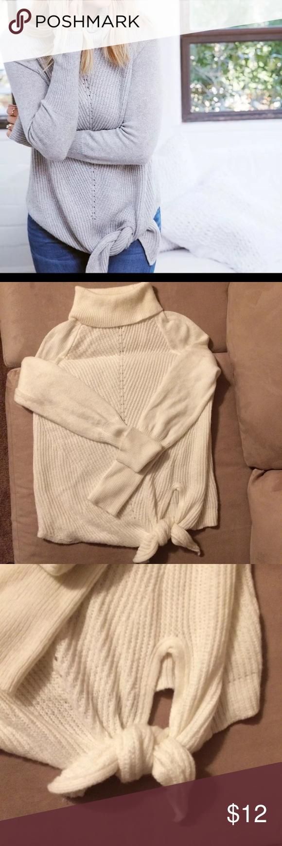 Lauren Conrad sweater White/cream turtle neck sweater with tie detail at the bottom . Was purchased but never used. LC Lauren Conrad Sweaters Cowl & Turtlenecks