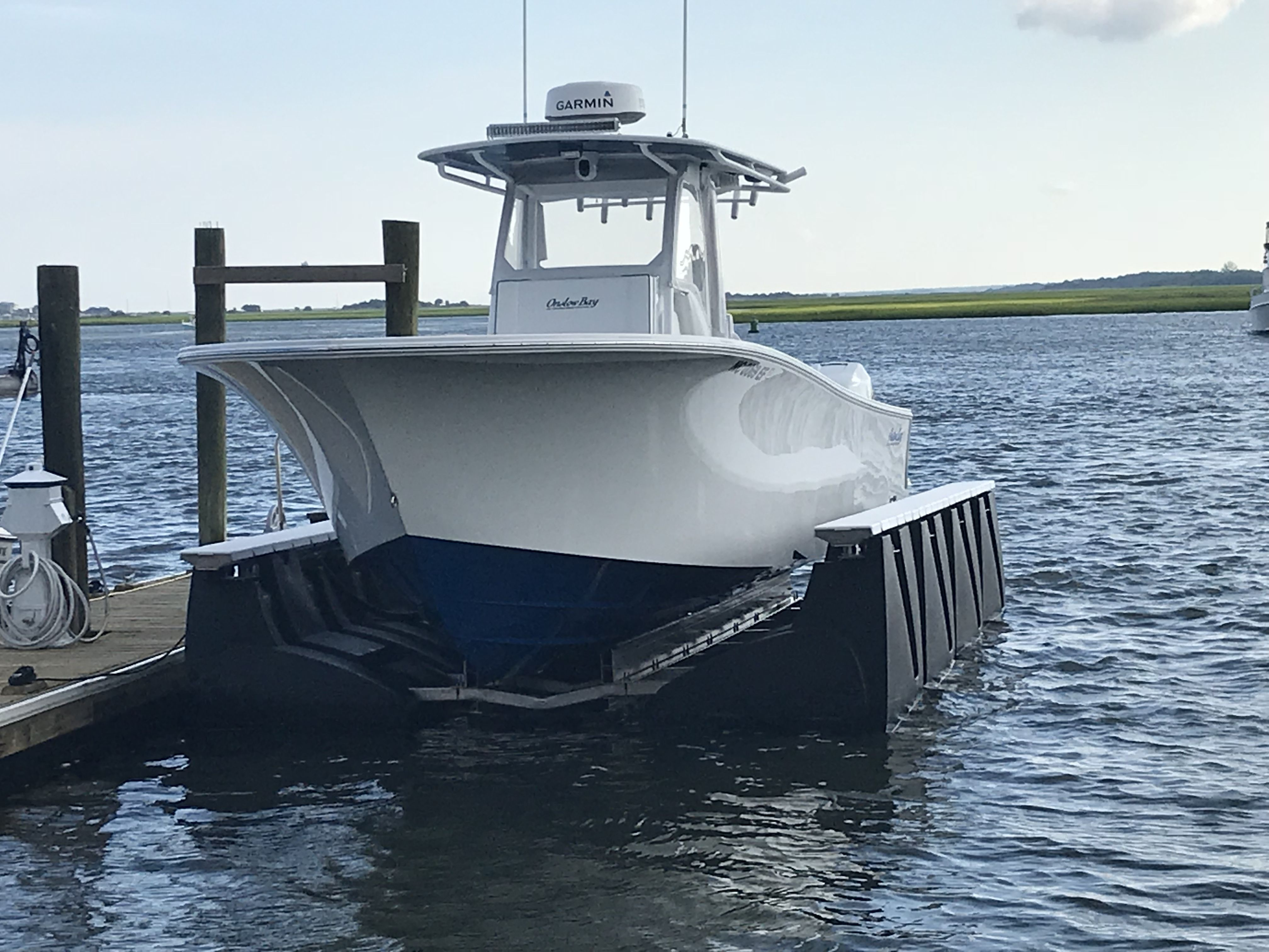 15,000# Capacity Floating Boat Lift with a 33' Onslow Bay CC Boat in  Wrightsville Beach NC #floatingboatdock, #boatdock, #floating… | Floating  boat, Boat lift, Boat