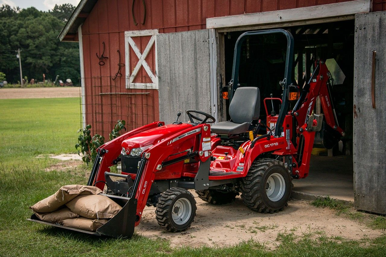 Mey Ferguson Gc1700 Series Sub Compact Tractor With Dl95 Loader And Cb65 Backhoe Moving Seed Bags
