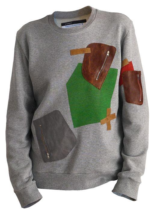 STARBEIT Sweater mit Farbflächen und Ledertaschen.