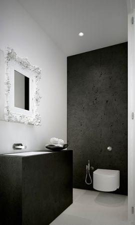 baño pequeño, mueble color carbón con lavabo integrado, grifo de pared, espejo con marco color blanco, sanitarios flotantes, pared pintada de gris. presupuestON.com