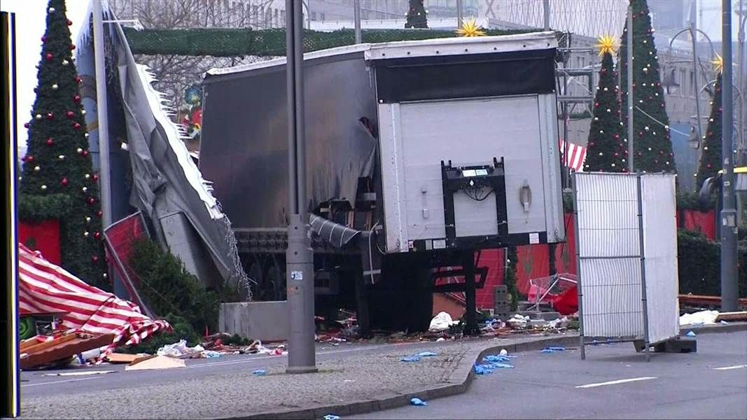 Berlin truck attack: ISIS claims responsibility amid urgent search for suspect