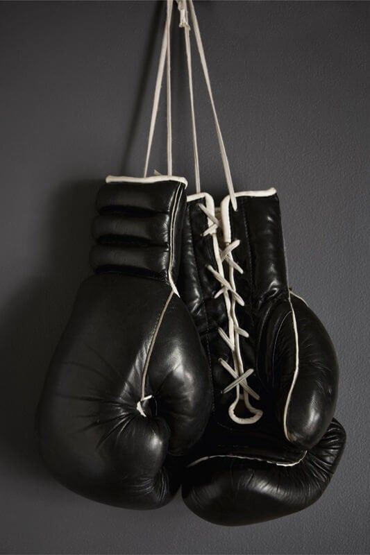 bb2ea897a Boxing Gloves Hanging on a Wall. Luvas De Mma