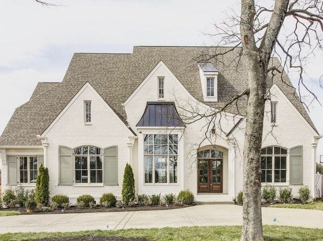 Such A Welcoming Home Great Buttercream Color And Shutters