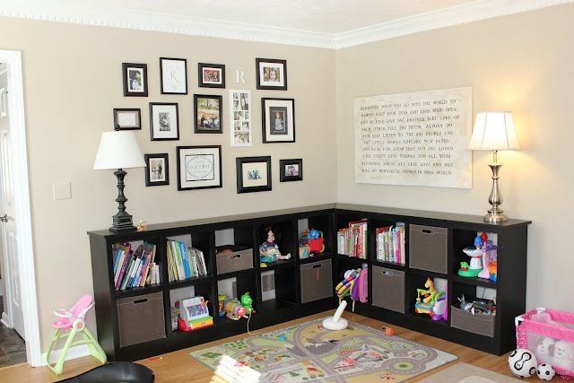 It Doesnt Have To Be Toys. I Just Like The Arrangement With The Frames.  Poetry On The Wall... Nice Black Furniture With Good Storage.