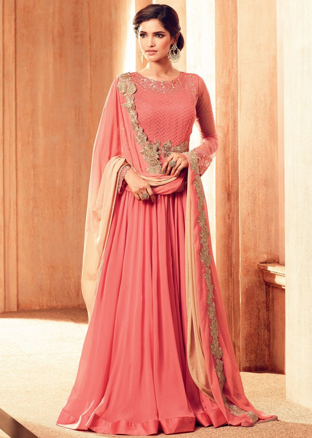 Look spectacular in this peach georgette front slit designer kameez