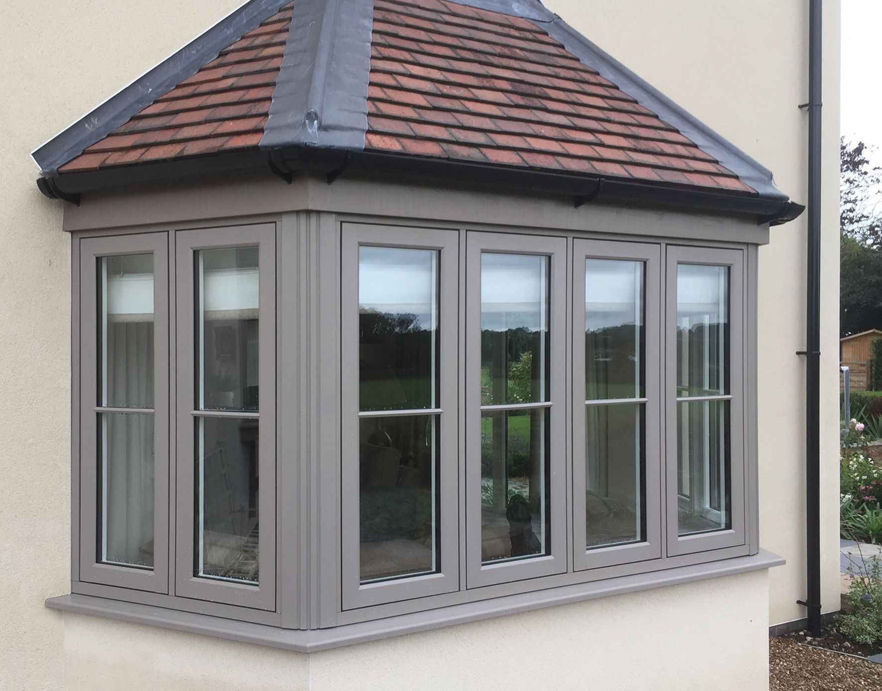 Flush Frame Bay Window In A Warm Grey Coloured Windows