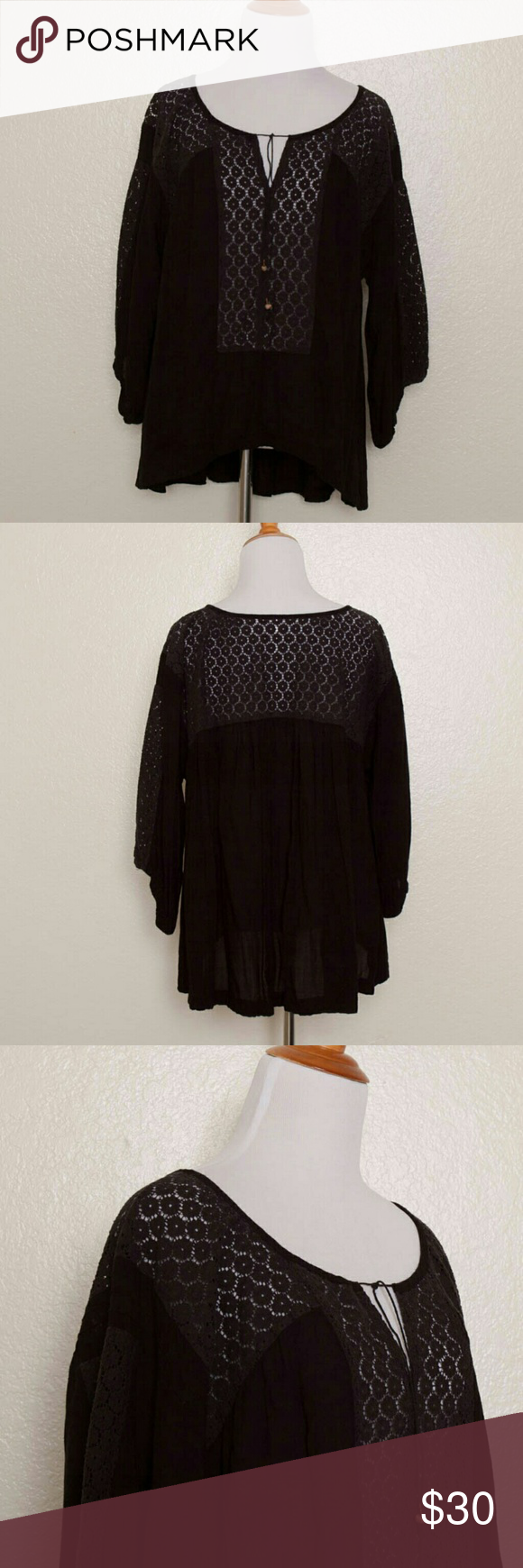Free People Black Lace Inset Peasant Tunic Black, lace inset and semi-sheer swing tunic with tie at the neckline Elasticized sleeve cuffs 100% Rayon Lace: 70% Nylon, 30% Cotton Machine wash or dry clean Made in China  Measurements: Bust: 46? Waist: 48? Sleeve Length: 15? Overall Length (in front): 24? Overall Length (in back): 27?  Condition: Top is clean and shows minimal wear; no holes, stains, pulls, or pilling. Free People Tops Tunics