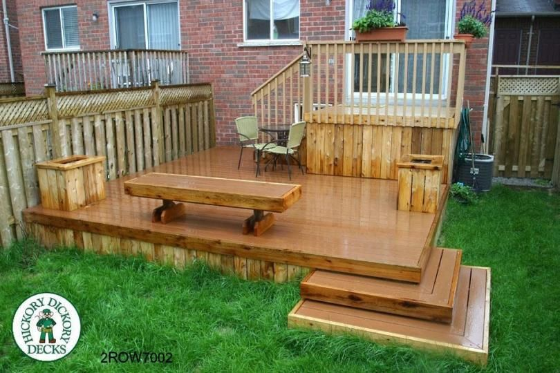 Garden Ideas On Two Levels corner stairs. medium size, two level deck with a bench and