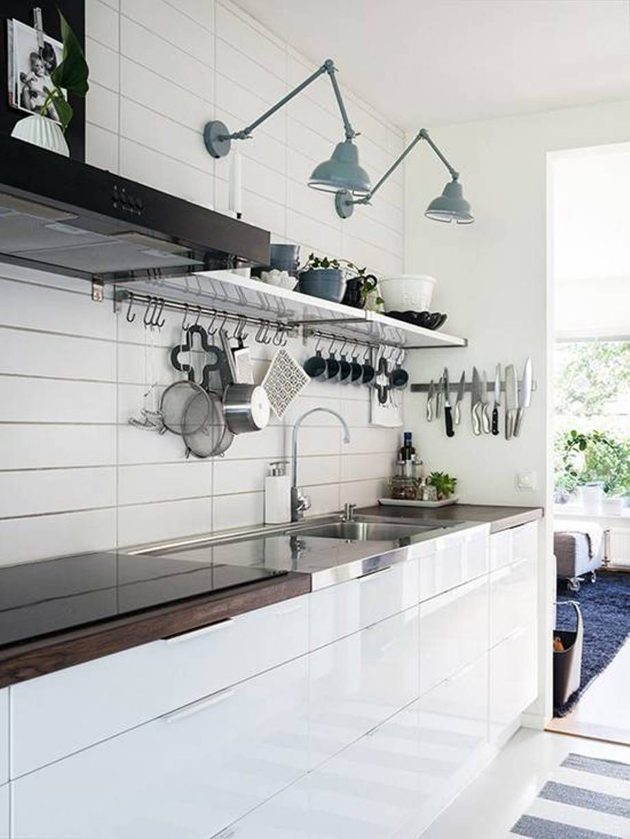 Swing Arm Light Fixtures Light Blue Color Over Open Shelves And ...