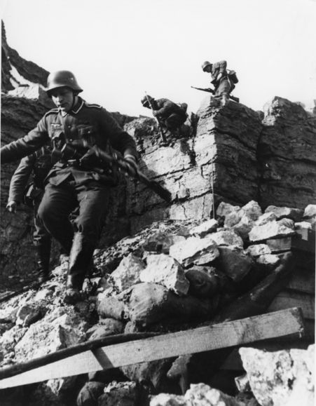 German Soldiers Maneuvering Through Rubble, February 23, 1940
