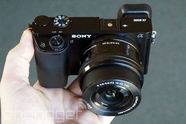 Sony S A6000 Is The Mirrorless Camera You Ll Want To Own Ships This April For 800 With Lens Sony Camera Camera Hacks Camera