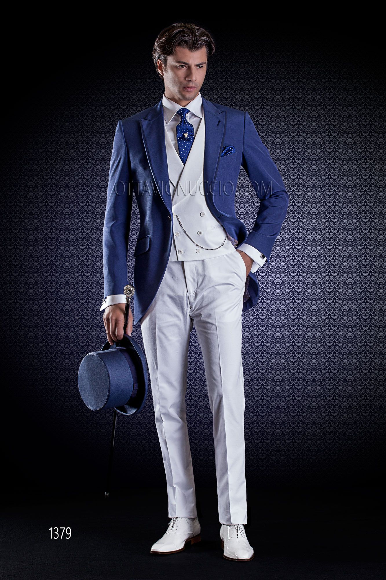 Electric blue tuxedo jacket with white pants and double-breasted vest