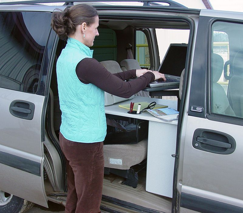 Laptop Arm Being Used Outside Of A Chrysler Town Country