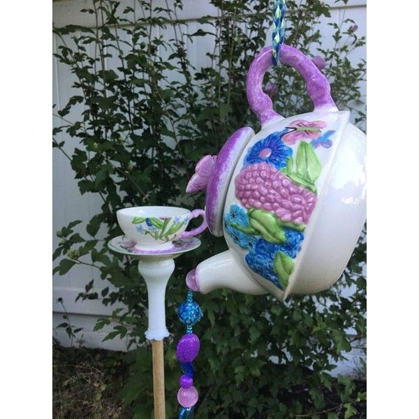 bird feeder stake and teapot garden hanging ❤ liked on Polyvore