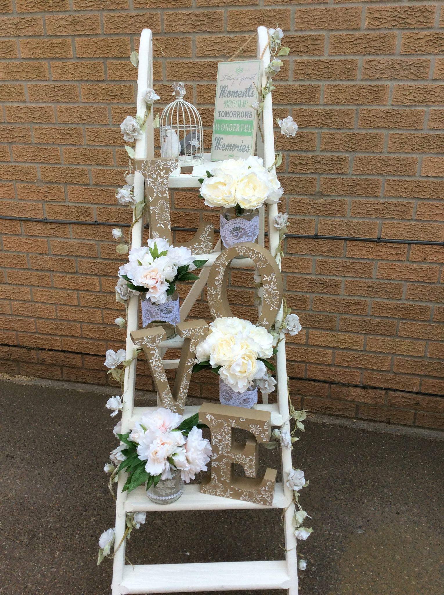 White ladder of love with rustic love letters and jars of cream white ladder of love with rustic love letters and jars of cream white flowers for hire perfect wedding idea scene setters for venue decorations check us junglespirit Choice Image