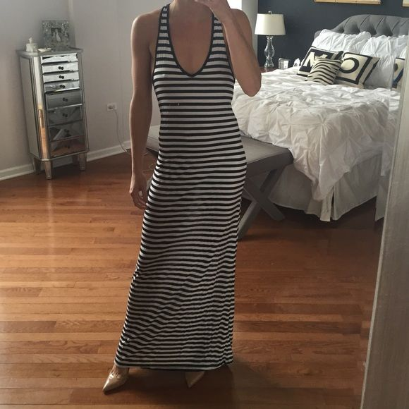 Black and white cotton maxi dress Black and white striped, comfortable maxi dress with low neckline and open crossover back. Made by 291. 100% cotton. Never worn. Purchased from Revolveclothing.com 291 revolveclothing.com Dresses Maxi