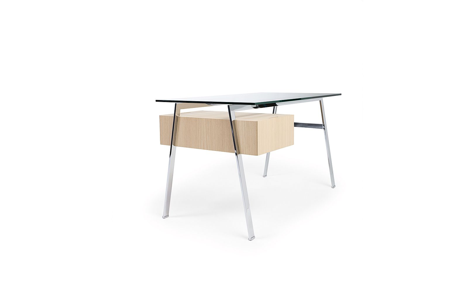 The Homework Desk is an elegant and highly versatile work desk that is available in two sizes. Both desks can be ordered with single, double, or file drawers, and may be configured according to individual needs. Attractive from all sides and made from select materials, Homework is ideal for the home or office where a desk will be on view.An innovative detail allows the drawers to \'float\' below the glass top giving lightness to the design while also providing additional table area. Each…
