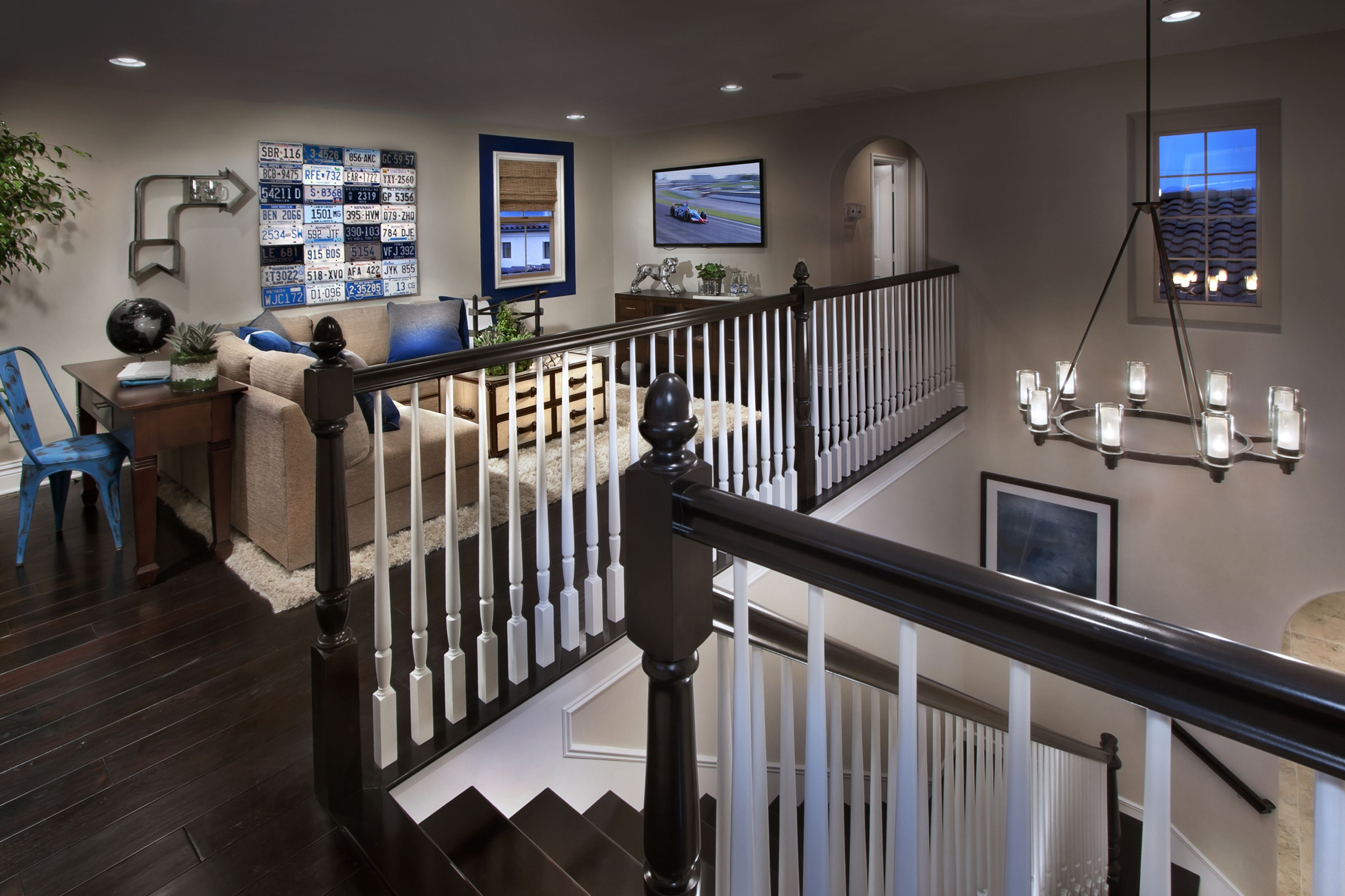 A Family Loft Stylish Staircase And Chandelier Light Up The