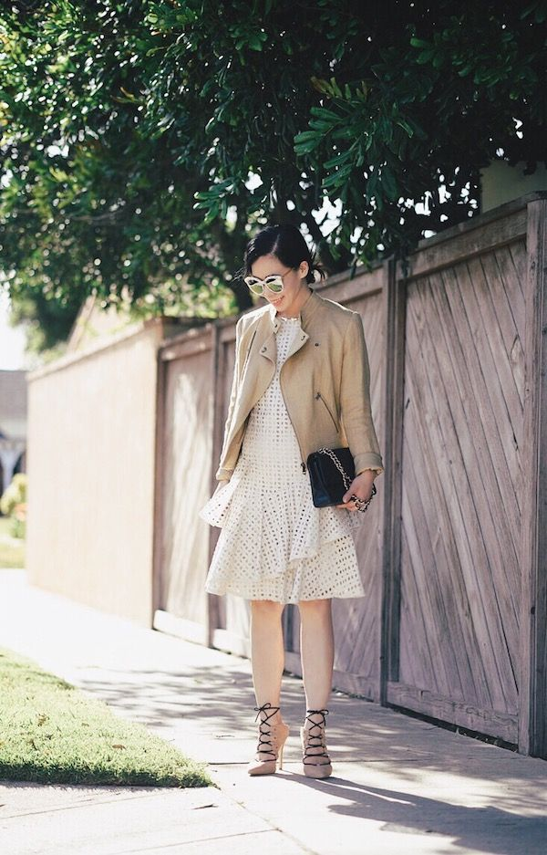 3e6ad1926826 Love the way Hallie Daily styled our Donna Morgan Lacey dress with a Ralph  Lauren moto jacket! So chic!  ootd  lacedress  fashion