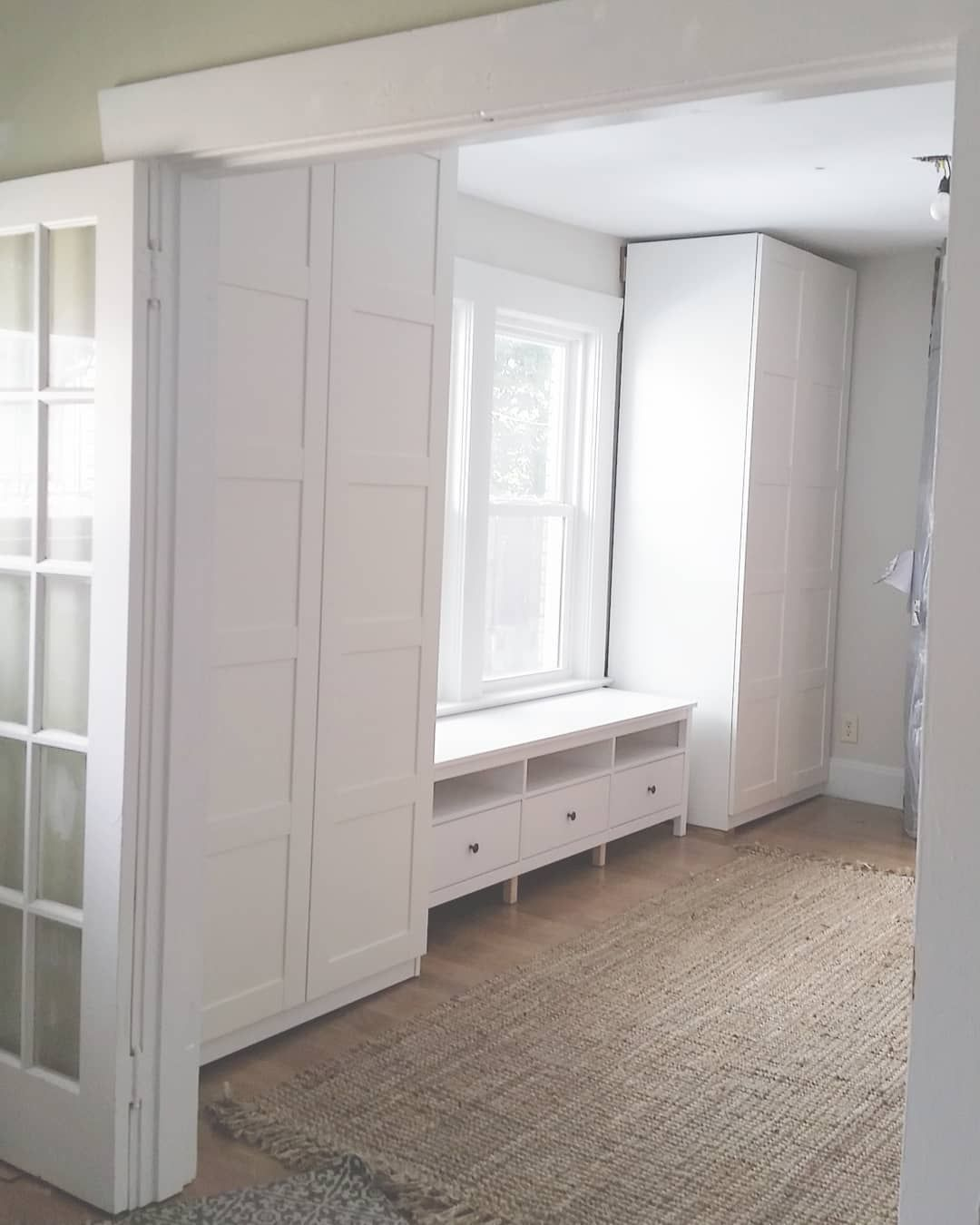 IKEA Pax Wardrobes and Hemnes TV stand as dining room