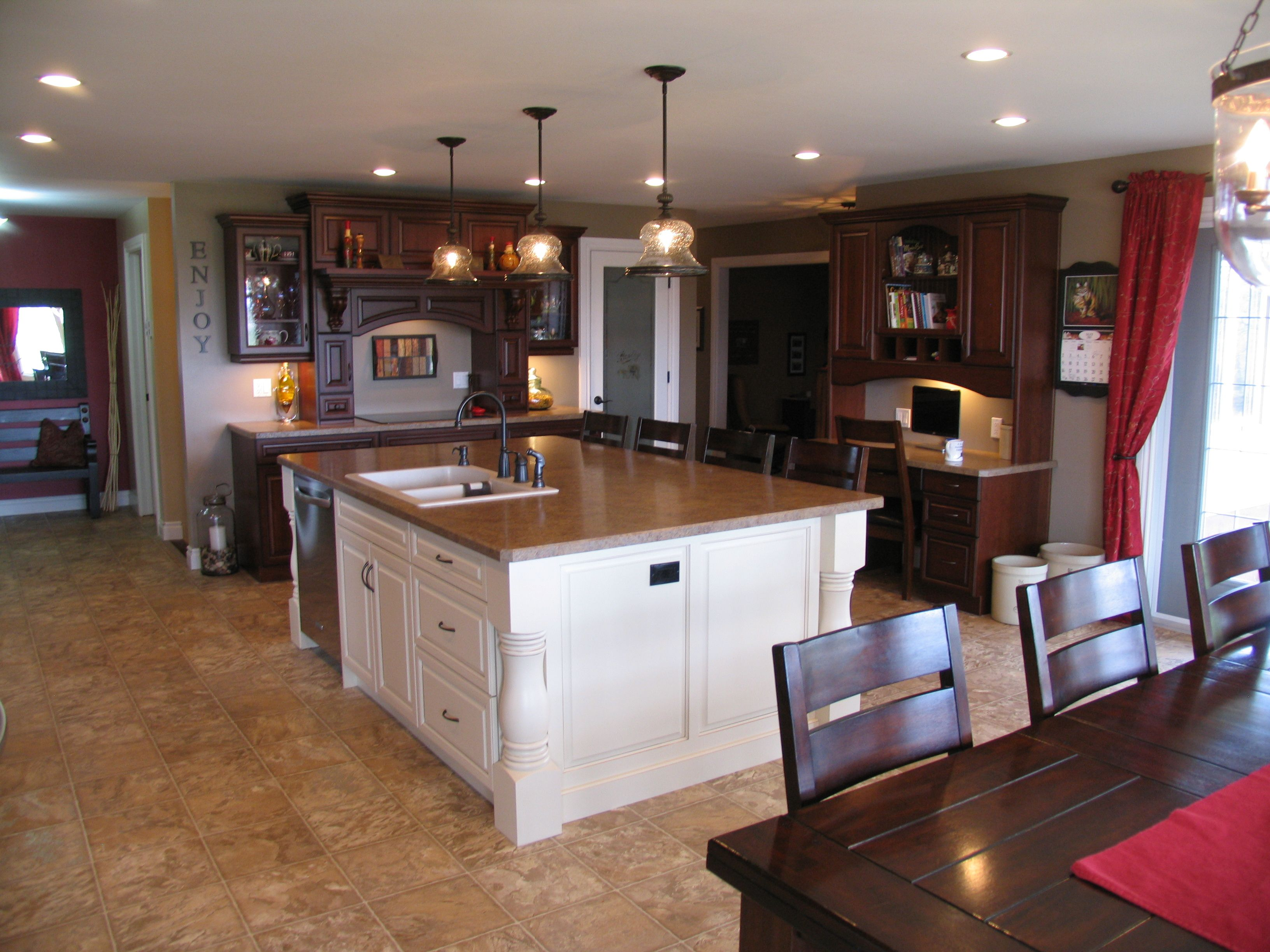 kitchen cabinets: cherry - saddlebrown, island cabinets: maple