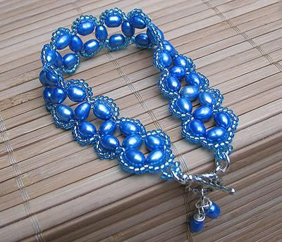 This bracelet is made of Japanese seed beads and freshwater pearls ...