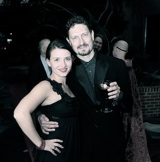 In my Issey Miayke tux from the CAST Gala 10/8/11, with Elise on the Red Carpet.  I was the volunteer Events Planner for this party, 200 plus, mailed invitations, oyster bar, and came in under budget.