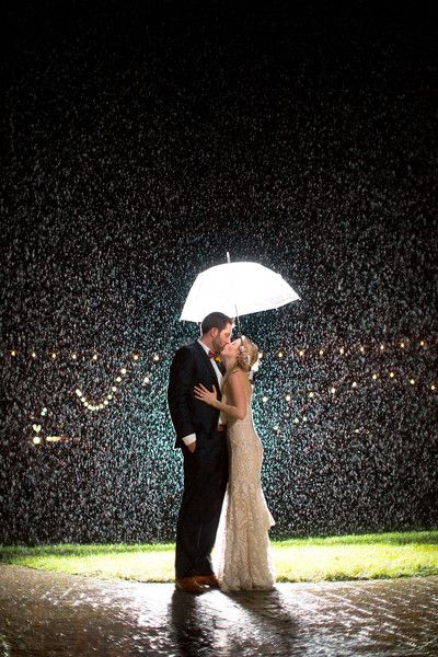 Beautiful + amazing rainy wedding day photo - bride and groom in the rain {Sam Stroud Photography}