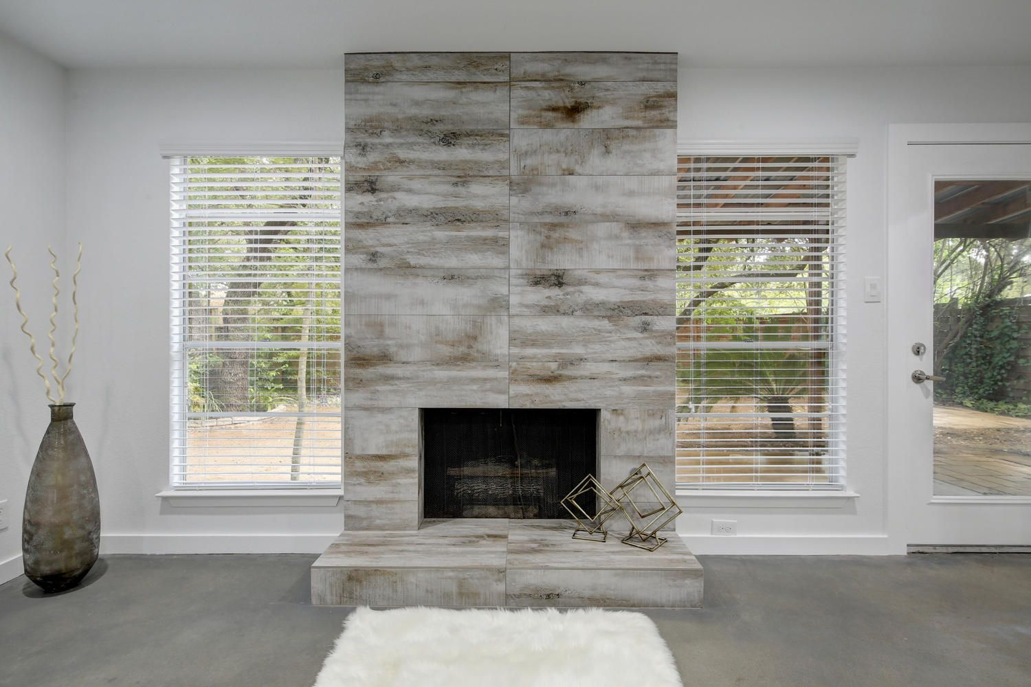 Fireplace remodel wood look tile with monolithic grout