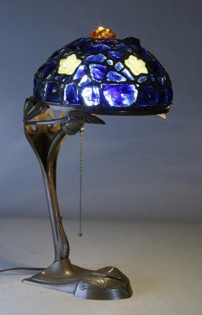 A period austrian chunk jewel leaded glass lampshade on a bronze art nouveau style base