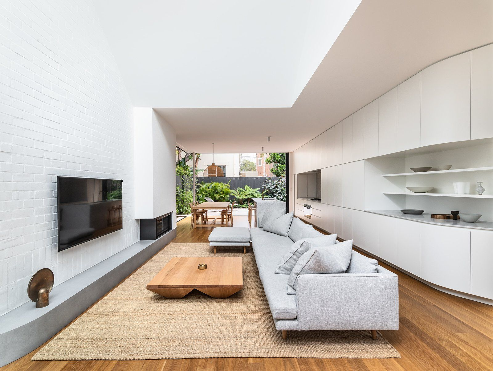 Modern home with living room corner fireplace sofa gas burning